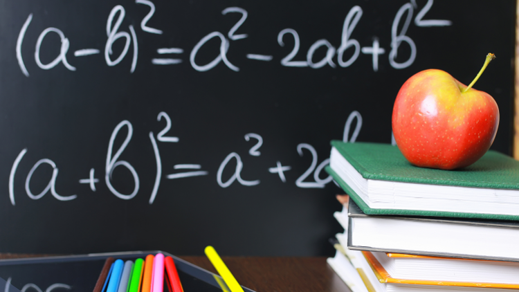 Algebraic equation on the blackboard when teaching KS2 students algebra