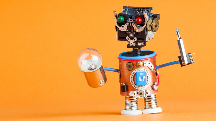 A friendly robot holding tools to start his science, technology, engineering, arts and maths lesson