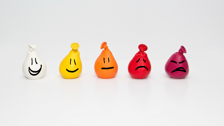 Balloon faces expressing a number of emotions