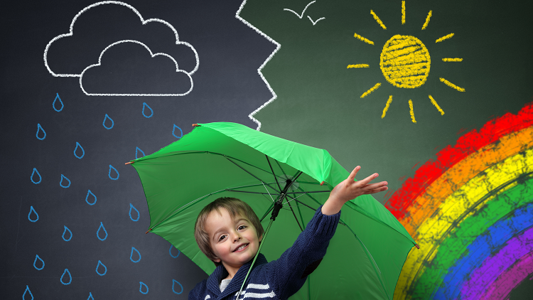 Primary pupil holding an umbrella standing in front of different types of weather
