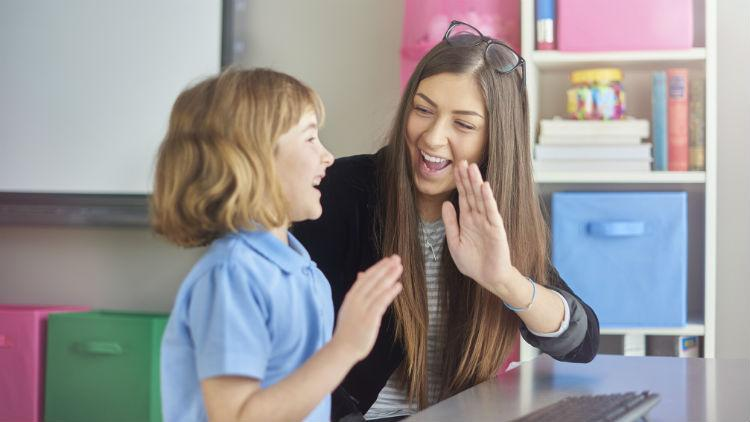 A supply teacher with a happy child