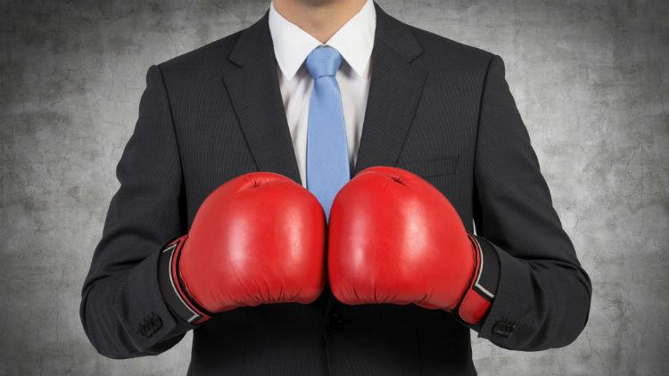 A teacher in boxing gloves