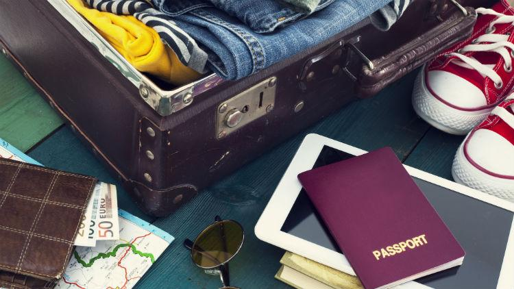 A suitcase and passport