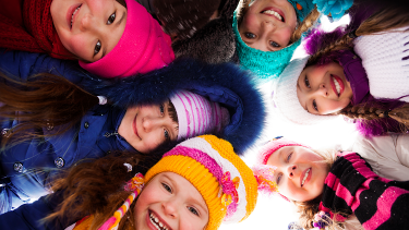 Images of children wearing coats, hats and scarves as part of the EYFS and primary winter collection of teaching resources
