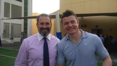 A teacher with Brian O'Driscoll in Abu Dhabi