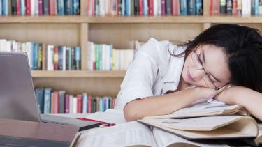 A pupil asleep on her revision