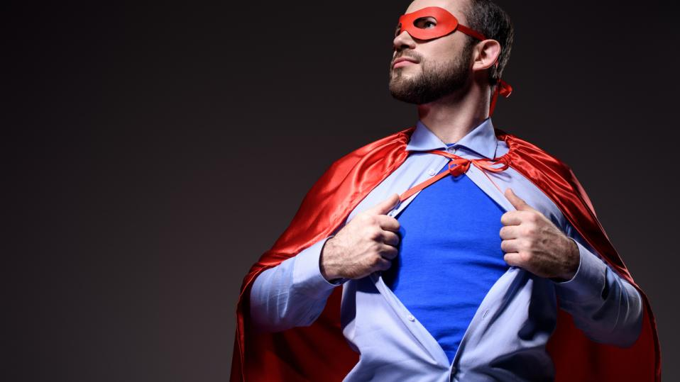 Man rips off shirt, to reveal superhero costume