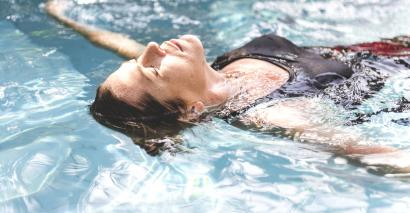Woman, relaxing in swimming pool