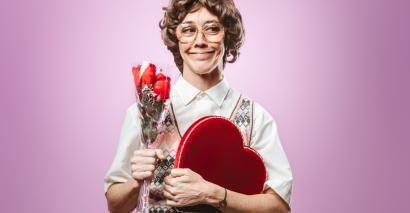 Awkward woman, holding flowers and chocolates