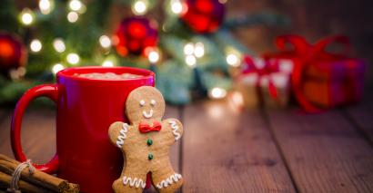 Festive scene of ginger bread person and mug of cocoa