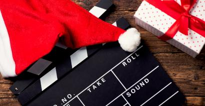 Film clapper board with Santa hat and present