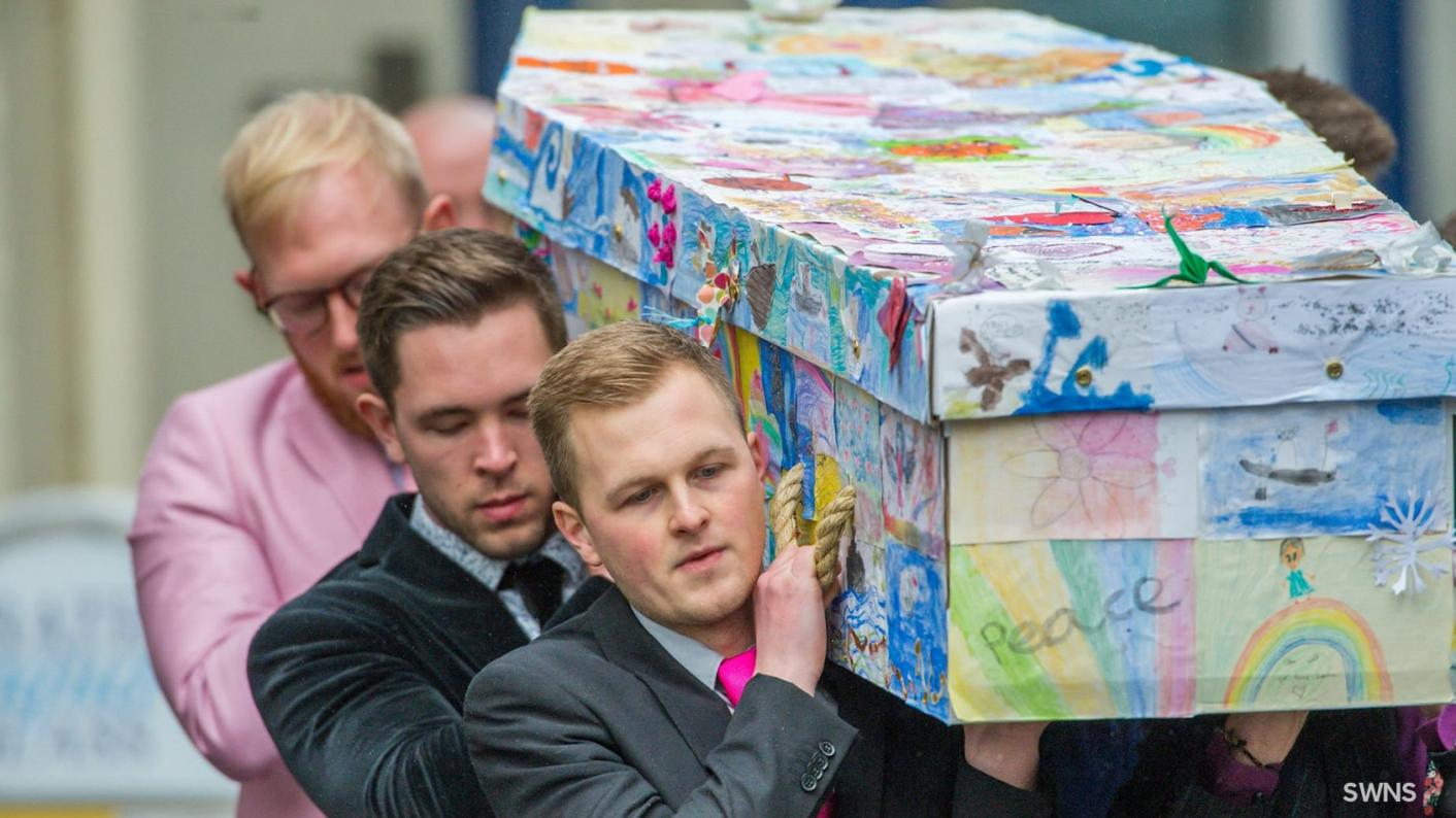 Beloved head's coffin covered in pupils' drawings