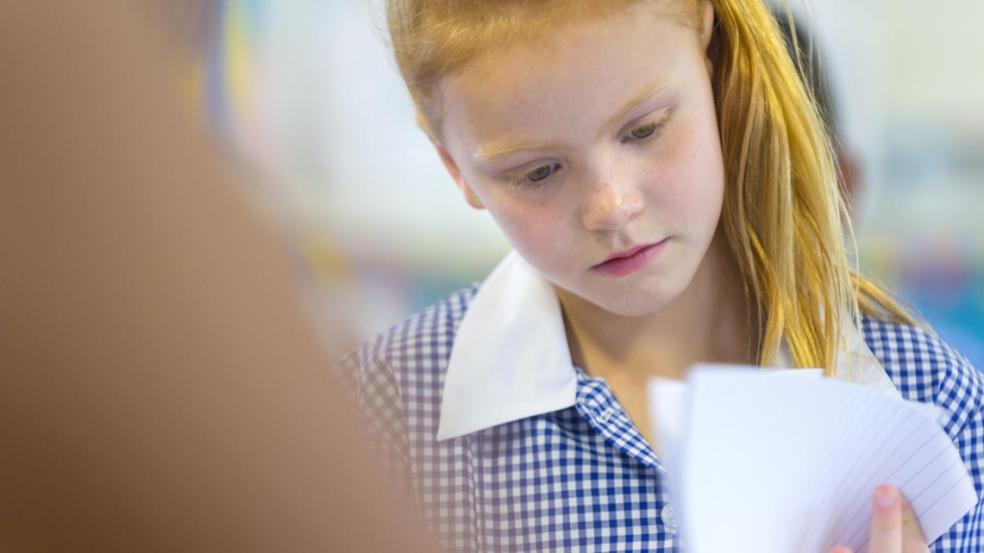 girl looking at test paper
