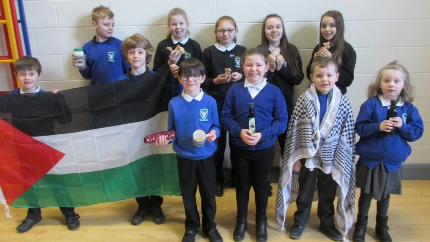 International links: Pupils at Lockerbie Primary School investigating 'Culture in a Box' items sent from a school in Palestine