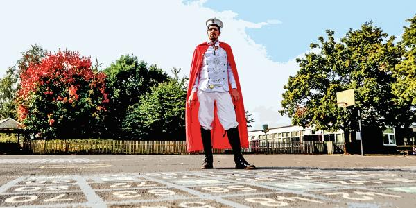 Caped crusader's mission to promote kindness in schools